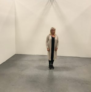Anne Buresh in empty room she designed at the Western Design Conference