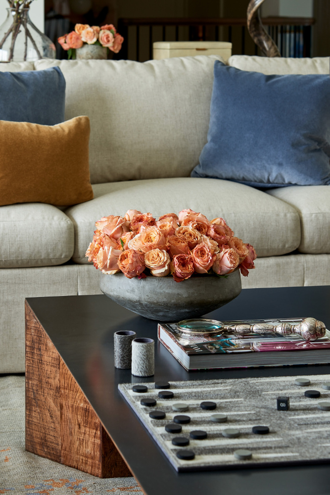 flowers on a coffee table interior design living room show house