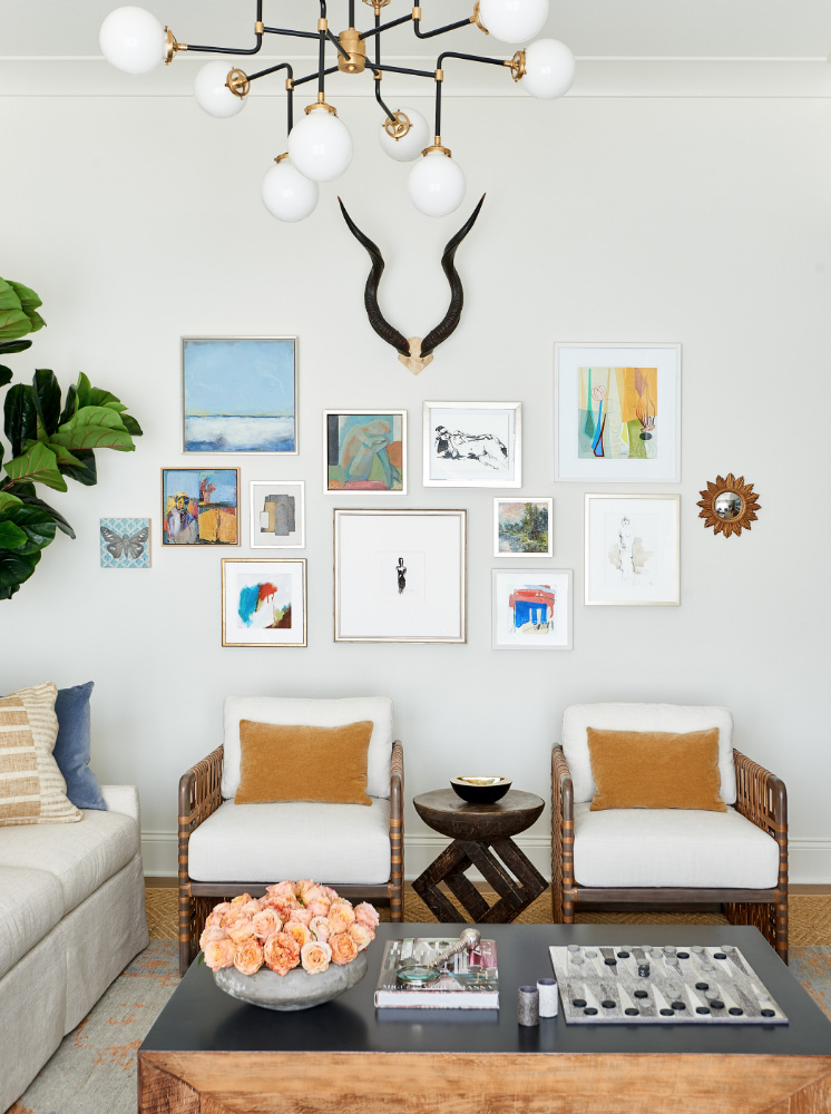 gallery wall with antlers interior design show room anne buresh