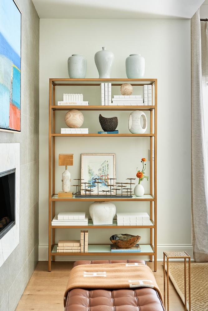 shelf with vases art and accessories anne buresh interior designer